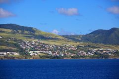 Houses on the Green Hills of St Kitts stock image