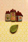 Houses and green leaf Royalty Free Stock Images