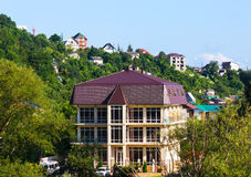 Houses among the green mountains Stock Images