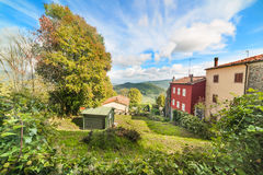 Houses in a green valley in Tuscany Stock Images