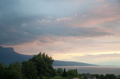 Houses and Greenery besides Lake Geneva at Sunset Stock Photos