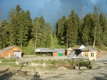 Houses in Gulmarg-Kashmir-1. A traditional wooden cottages in Kashmir with a greenery in the backdrop Royalty Free Stock Photos