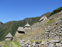 Houses and hanging gardens at Machu Picchu Royalty Free Stock Photos