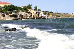 Houses hanging over the sea. Sea Village. royalty free stock photos