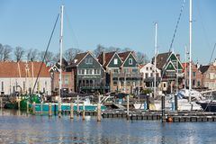 Houses and harbor historic fishing village Urk in The Netherlands. Urk, The Netherlands - February 15, 2019: Houses and harbor of old historic fishing village royalty free stock photography