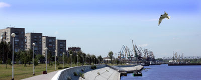 Houses and harbour cranes on the embankment Royalty Free Stock Photography