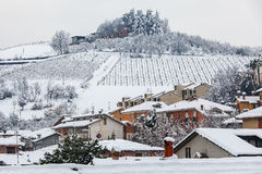 Houses on the hill covered with snow. Stock Images