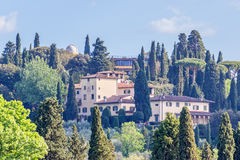 Houses on a hill. Observatory on a hill in a village Stock Photos