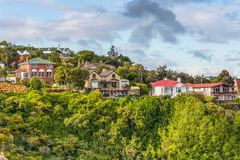 Houses on hill at Port Chalmers, New Zealand Royalty Free Stock Image