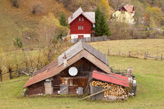 Houses on the hill. Some old houses in Podul Dambovicioarei village in autumn, Brasov county, Romania stock photography