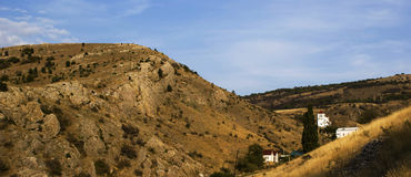 Houses on the hills. Rural landscape. Panorama of houses on the hills Stock Photos