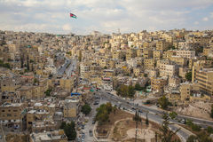 Houses on the hills of downtown Amman with Jordan flag Royalty Free Stock Images