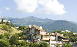 Houses in hills Stock Photography