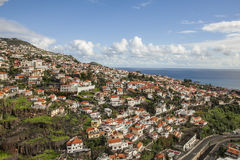 Houses on the hills seen from the cable car, Funchal, Madeira. Stock Photos