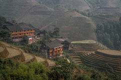 Houses on the hills. A shot of traditinal wooden houses on the hill. The shot was taken in Guilin, China Stock Photography