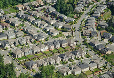 Houses on Hillside - Aerial. New housing development along hillside Royalty Free Stock Image