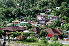 Houses on hillside at Padang, Indonesia. Houses on the hillside along the river Muaro in old Padang city, West Sumatra royalty free stock photography