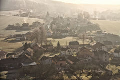 Houses on the hillside with smoking chimneys Royalty Free Stock Photos