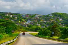 Houses with a hillside view. The beautiful scenes of hills and houses from the highway road in the Caribbean island of Jamaica stock photos