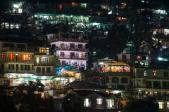 Houses at Himalaya mountains at night in Dharamsala, India Royalty Free Stock Images