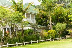 Houses Homes Tropical Landscaping. Houses homes surrounded green tropical landscaping trees vegetation on gated golf course royalty free stock image