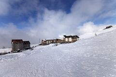 Houses and hotels on ski resort, view from ski slope Stock Image