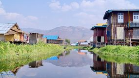 Floating village at Inle Lake Myanmar. The houses in Inle Lake are constructed on wooden piles, even the school. The villagers get around with small boats stock photo