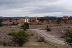 Houses in the inner land of Morocco. Three Moroccan houses near the road Stock Photos