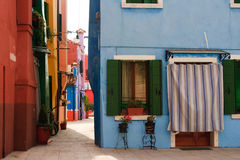 Houses on Island of Burano, Venice. View of the colourful houses on the Island of Burano near Venice Italy with door shutters and flowers Stock Photography