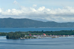 Houses on an island on the lake Sentani royalty free stock photo