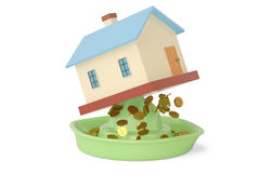 Houses on the juicer, into gold.3D illustration. Stock Photos