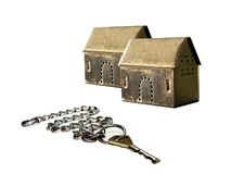 Houses and key. Key with chain and two houses stock image