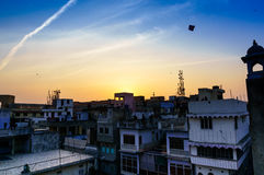 Houses and kites at sunset in jaipur Stock Photography