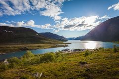 Houses at the lake. Gjende in Jotunheimen norway royalty free stock photo