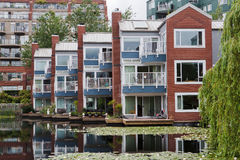 Houses on a lake with Vitoria Regia Vancouver Stock Images