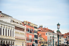 Houses and lamp-posts on the Grand Canal on a quiet day of spring, Venice, Italy Royalty Free Stock Images