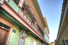 Houses in Las Peñas neighborhood. View of the second floor of some old houses and its windows, in Las Peñas neighborhood, Guayaquil, Ecuador Stock Photos