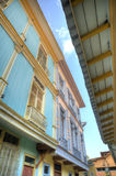 Houses in Las Peñas neighborhood. View of the second floor of some old houses and its windows, in Las Peñas neighborhood, Guayaquil, Ecuador Royalty Free Stock Photos