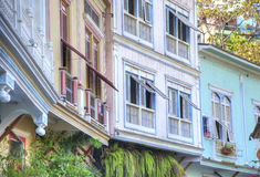 Houses in Las Peñas neighborhood. View of the second floor of some old houses and its windows, in Las Peñas neighborhood, Guayaquil, Ecuador Stock Image