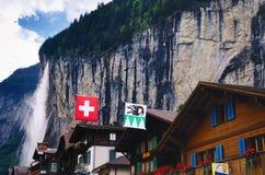Houses in Lauterbrunnen (Switzerland) and Staubbach Falls Stock Photo