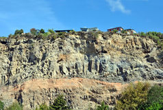 Houses left Stranded on Cliff Edge by Earthquakes, Christchurch. Houses in the Suburb of Sumner, Christchurch, New Zealand are left stranded on a cliff top edge Royalty Free Stock Image
