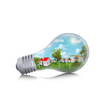Houses in the light bulb Royalty Free Stock Images