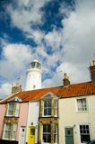 Houses and lighthouse Stock Photos