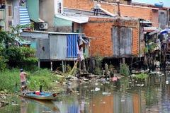 Rubbish strewn river in Ho Chi Minh City, Vietnam. Houses lining banks of rubbish strewn river in Ho Chi Minh City, Vietnam Stock Photo