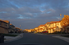 Houses lit by evening sun Royalty Free Stock Image