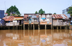 Houses of local people staying along river Royalty Free Stock Photos