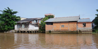 Houses of local people staying along river Royalty Free Stock Images