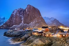 Houses in the Lofoten islands bay. Natural landscape during sunrise royalty free stock photo