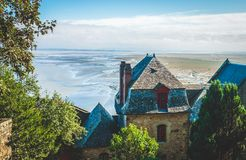 Houses and low tide. Houses inside walls of Le Mont Saint-Michel island famous for its low tide, in Normandy, France stock photography