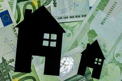 Houses made of blackboard with a hundred euro bills as a background.mortgage consept stock photography